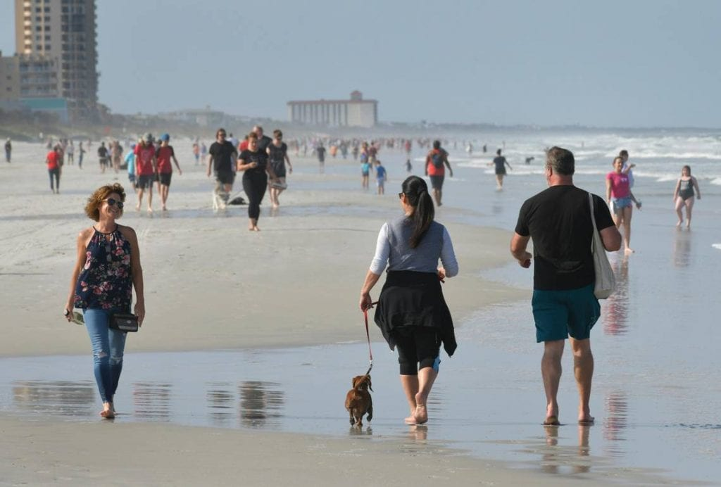 Packed Florida beach offers glimpse of what may come when outdoor spaces are reopened